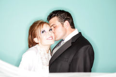 Happy wedding kiss. Fun and modern wedding portrait Royalty Free Stock Images