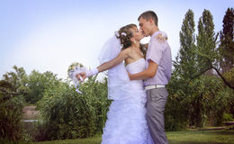Happy wedding. Loving couple embracing on a riverside Royalty Free Stock Photos