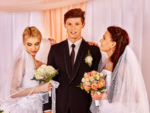 Happy wedding man and two bride Royalty Free Stock Photography