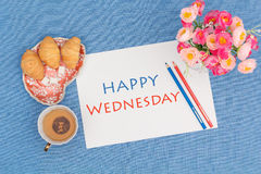 Happy Wednesday, croissants with green tea and flowers. View from above royalty free stock images