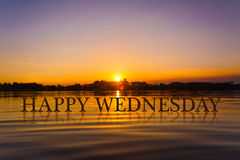 `HAPPY WEDNESDAY` with sunset water , twilight time Royalty Free Stock Image