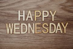 Happy Wednesday text message on wooden background. Top view Happy Wednesday alphabet letters text message on wooden background royalty free stock images