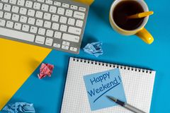 Happy Weekend message in notebook on office desk with empty space for text, mockup or template Royalty Free Stock Image