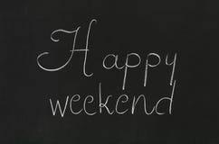 Happy weekend. Phrase handwritten on the school blackboard Stock Photography