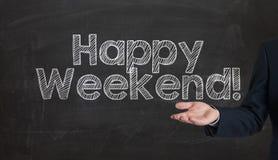 Happy weekend phrase handwritten on the school blackboard presen Royalty Free Stock Photo
