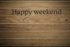 Happy weekend on wooden background. Wooden surface is stamped with Happy weekend background with copy space royalty free stock photos