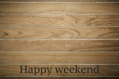 Happy weekend on wooden background. Wooden surface is stamped with Happy weekend background with copy space stock photos
