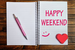Happy weekend words. On notebook Royalty Free Stock Images