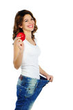 Happy weight loss woman isolated on white. Happy weight loss woman with red apple isolated on white background Royalty Free Stock Photo