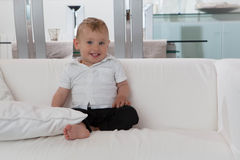 Happy well behaved toddler sitting at home Royalty Free Stock Image