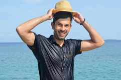 Happy wet man at the seaside. Summer fan Royalty Free Stock Image