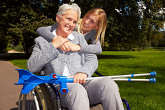 Happy wheelchair user in a park Stock Photo