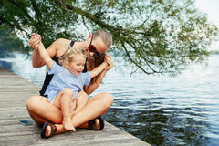 Happy white Caucasian mother and daughter child having fun outside stock photos
