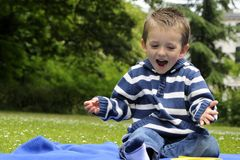 Happy white child playing in park Stock Photography