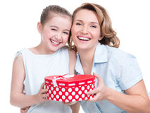 Happy  white mother and young daughter hold present Stock Image