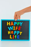 Happy wife happy life with magnetic colored letter blocks on blackboard Stock Image