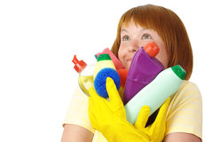 Happy wife holding dish washing liquids Royalty Free Stock Image