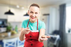 Happy wife holding showing and offering gingerbread royalty free stock image