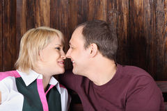 Happy wife and husband touch each other noses Royalty Free Stock Photography