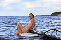 Happy windsurfer sitting on the board Stock Image
