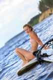 Happy windsurfer sitting on the board Royalty Free Stock Image