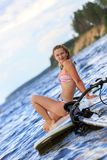 Happy windsurfer sitting on the board Stock Image