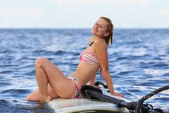 Happy windsurfer sitting on the board Royalty Free Stock Photo