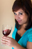 Happy Wine Taster. A young woman holding a glass of red wine Royalty Free Stock Image