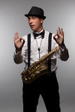 Happy and winking saxophone player Stock Images