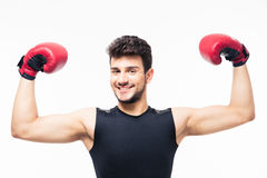 Happy winner boxer raising arms in the air Stock Photos