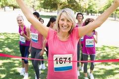 Happy winner of breast cancer marathon race Stock Photos