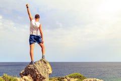 Happy winner climber reaching life goal success man Stock Photos