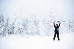 Happy winner female skier. Happy winner girl holding skis up Royalty Free Stock Photography
