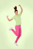 Happy winner girl. Isolated on a green background Royalty Free Stock Images