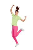 Happy winner girl jumping. Isolated on a white background Royalty Free Stock Images