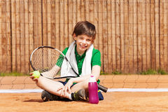 Happy winner having rest after tennis match Royalty Free Stock Photo
