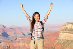 Happy winner hiker in Grand Canyon cheering. With arms raised up in winning gesture enjoying the beautiful landscape. Hiking girl wearing backpack during summer Royalty Free Stock Photo
