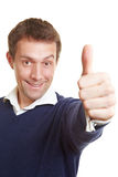 Happy winner holding thumbs up Stock Photos