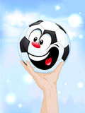 Happy winner -  soccer ball in hand Stock Photography