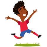 Happy winning african cartoon footballer jumping joyfully. Happy winning african cartoon footballer wearing red shirt and blue shorts jumping joyfully isolated Stock Photos