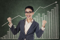 Happy winning businesswoman with arms up Stock Photos