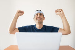 Happy after winning a sports bet. Happy man with hands raised in the air after winning a sports bet Stock Photos