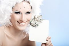 Happy winter beauty holding fancy present Royalty Free Stock Photo