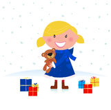 Happy winter blond child and christmas gift Stock Photos