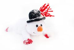 Happy winter christmas snowman with carrot in black hat Stock Photos