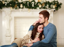 Happy winter couple in love at home Stock Photo