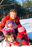 Happy winter family Stock Images