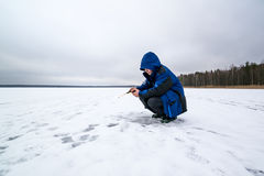 Happy winter fishing in a lake Royalty Free Stock Photo