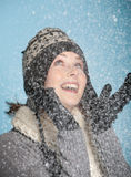 Happy winter girl. Beautiful blond girl with warm winterclothes looking happy it is snowing Stock Photos
