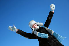 Happy winter girl with hands up Stock Photography